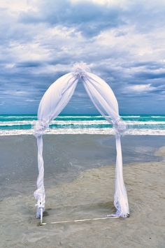 Stock image of 'Wedding archway arranged on the sand'