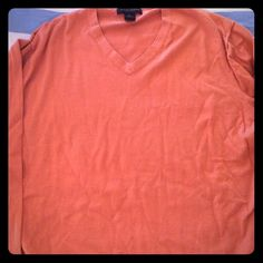 NWOT mens Banana Republic pullover sweater sz XL New without tags men's Banana Republic sweater, orange, sz XL, luxe v-neck, 5% cashmere, 30% silk. Tiny hole that was there when we bought it, as shown. Banana Republic Sweaters