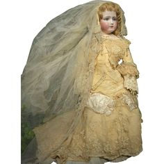 A most stunning Victorian bride doll. Dressed in her original bridal ensemble, this Poupee is one of the most beautiful Portrait Fashion dolls we have