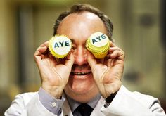 SNP leader Alex Salmond plays up for the cameras during a visit to Brownings Bakers bakery in Kilmarnock where he was presented with Scottish Independence Referendum Aye branded cakes.
