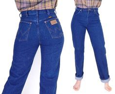Curvy 1980s vintage high waisted women's jeans by Wrangler in a dark indigo rinse with a fitted seat and straight leg cut. CONDITION: Excellent vintage- Very light fading, no rips, stains, or holes. H