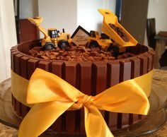Kit-Kat Construction Birthday Cake...  Ok Aunt @Tracie Zamiska Zamiska Smith  This is the theme I'm going with for saw so I will need this cake! :)