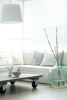 """Oversize decor and furniture pieces - when well selected! - always bring a sense of calm and peaceful reassurance to the space. Look how beautiful this space looks and feels! Notice the big pendant and huge glass vase """"embracing"""" the space. Also love the low coffee table on wheels, lovely! More tips: http://FengShui.About.com"""