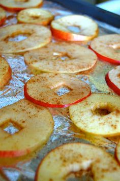 The Newfangled Housewife: Baked Apple Chips  reheat your oven to 275. Line a cookie sheet with parchment paper. *Aluminum foil also works, just make sure to spray it!* - Take the cores out of your apples. I don't have a tool that makes this easy, but it wasn't that bad doing without! - Slice your apples as thin as you would like.