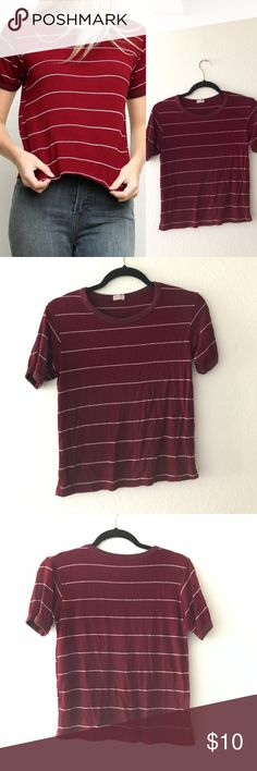 Brandy Melville red burgundy ringer t-shirt top Worn like 4 times. Brandy Melville red burgundy and white stripped ringer short sleeve t-shirt top. Really cute and slightly cropped fit! Super soft material as expected from brandy. From the john galt line at brandy. No damages. One size. Can fit an x-small to medium comfortably Brandy Melville Tops