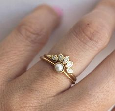 Check this moissanite engagement ring set. Custom handcrafted in the finest detail, this white gold ring features a round cut moissanite beautifully set in a solid gold floral setting. A matching diamond wedding ring completes the sentiment. Vintage Engagement Rings, Diamond Engagement Rings, Solitaire Ring, Accesorios Casual, 14k Gold Ring, 18k Gold, Carat Gold, Gold Pearl Ring, Pearl Diamond