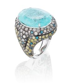 Pave yellow and white diamonds decorate the setting of this cocktail ring, with a 28.46 ct. oval-shape paraiba tourmaline center.    Miiori