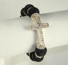 Stretchy wide rhinestone bracelet. I would like this with different black beads.