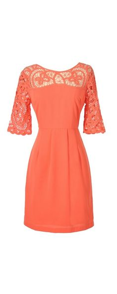Something Extra Crochet Lace Neckline Dress in Orange Coral at Lily Boutique $58