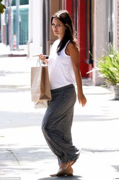 A pregnant and stylish Rachel Bilson picked up some sweets at Belwood Bakery in LA on June 24, 2014 http://dailym.ai/1yOntWg