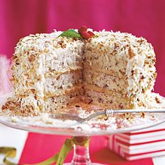 My son's favorite cake: Caramel Cream Cake: Three pecan cake layers with pecan pie filling, covered with cream cheese frosting, toasted coconut and toasted pecans. Serious eating.