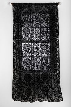 Damask curtains. These would look great in our bedroom with our damask lamp!