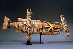 Malagan Figures, mid 1900s-  Unknown Artist, New Ireland, Papua New Guinea,wood, paint, fiber, and shell