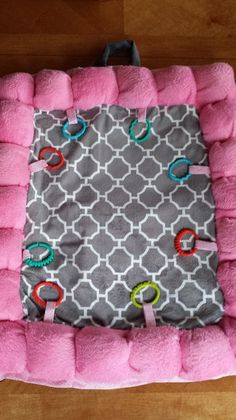 Activity mat with loops and rings to customize and interchange toys. by SewingPowers on Etsy