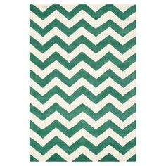 Showcasing a bold chevron design in vibrant tones, this hand-tufted wool rug adds texture to your living room or study. Team with neutral walls, clean lines and high-gloss furniture for contemporary style.  Product: RugConstruction Material: 100% WoolColour: Green and ivoryFeatures:  Hand-tuftedMade in IndiaPile Height: 1.6 cmNote: Please be aware that actual colours may vary from those shown on your screen. Accent rugs may also not show the entire pattern that the corresponding area rugs…