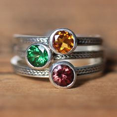 Gemstone stack ring set birthstone rings by metalicious, $420.00 ... except for ours it would be green amethyst... Rainbow topaz... london blue topaz...