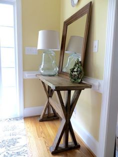 This table is built out of only2x4's - that's 5 boards for about $15! It was prettyeasy and took half a day. If the fancy angles are too hard to cut safely I recommend doing 45-degree angles! I'm happy to have a nice entryway - first time my whole life! :)