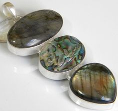 Weight 18 gms Description Gemstone : Labradorite, Abalone Shell  Length : 3.75 Inches including Bail  Width :1.75 Inches  Total Wei...