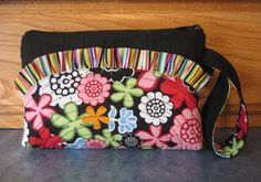 Black Multicolor Wristlet Purse with bullt-in wallet.