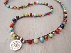 Colorful crochet necklace just for INSPIRATION!!! GLass beads would be awesome for this!: