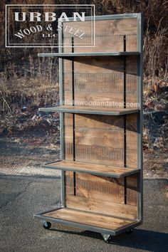 This industrial style shelving unit is the perfect piece to display merchandise, books, or just about anything else. This tough display is made from distressed reclaimed pine, waxed raw steel banding, and sits on steel casters. Comes with 3 36w x 12.5d shelves, and brackets to secure it to the wall (ITEM IS NOT FREE STANDING) DIMENSIONS: 37W x 72H x 18D *This item typically ships in 3-5 weeks.* Intended for indoor use. © 2014 URBAN WOOD & STEEL LLC. All materials, content and forms…