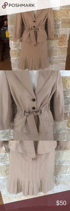 Kay Unger  suit Size 4 beige two piece Kay Unger suit very cute and stylish for work wood buttons with tie jacket with quarter sleeves pencil skirt with pleating back zipper 34 bust .waist in skirt is 30 inches skirt is 24 inches long both are fully lined material is viscose with nylon this suit has some stretch Kay Unger  Skirts Skirt Sets
