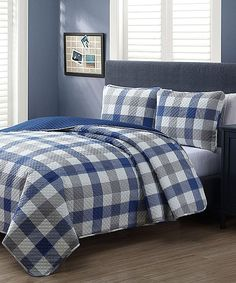 Updating your bedroom décor with a pop of color, this three-piece bedding set includes a polyester quilt and two pillow shams, so you can sleep comfortably and wake in refreshing style. Includes quilt and two shams100% polyesterMachine wash; tumble dryImported
