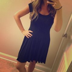 """Old Navy Essential Black Dress Super soft dress that easily dresses up or down. I am 5'4"""" for length reference. It is in like new condition. Old Navy Dresses"""