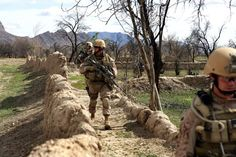 U.S. Marines with Explosive Ordnance Disposal, 9th Engineer Support Battalion, assigned to Company L, 3rd Battalion, 8th Marine Regiment, conduct a security patrol in the abandoned village of Now Zad, in the Helmand Province of Afghanistan, April 6, 2009. The residents have left their homes in fear of their lives from the strong insurgent presence. The 3rd Battalion, 8th Marine Regiment, is the ground combat element of Special Purpose Marine Air Ground Task Force - Afghanistan.