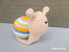 This little lady snail amigurumi would look perfect in your floral corner within cute flowerpots :)