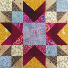 Part 3: Choosing Fabrics and Colors: Playing in the Mud - Laura starts with the Memory Star quilt block.
