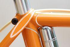 White pinstripe on orange paint