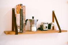 Leather Strap Hanging Wooden Shelf by OakAndAwl on Etsy Ledge Shelf, Hanging Shelves, Wood Shelf, Chandeliers, Leather Strap Shelves, Wooden Floating Shelves, Deep Shelves, Nursery Shelves, Home And Deco