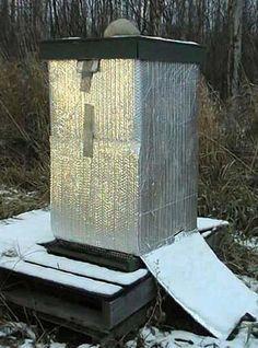 Alaska beekeeping, Solar Heating, Modern bee hive gadgets, hives wrapping, bees, bee behavior, beemax, polystyrene hives http://www.beebehavior.com/wrapping_hives_alaska.php