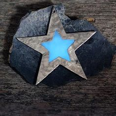 Handcrafted cast metal star. This ornament is made with Ecopoxy, an eco friendly plant based resin. Our glow in the dark stars at part of our Luminance Series