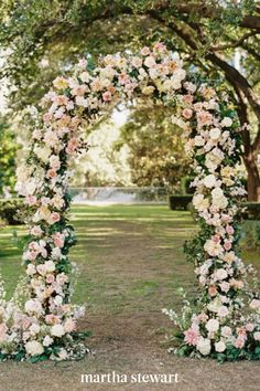Guests walked through, and under, beautiful blooms of pink, yellow, and white in this incredible wedding arch. #weddingideas #wedding #marthstewartwedding #weddingplanning #weddingchecklist Simple Wedding Arch, Wedding Arch Rustic, Floral Wedding, Wedding Flowers, Wedding Arches, Wedding Reception, Wedding Ideas, Woodland Wedding, Wedding Ceremony Decorations