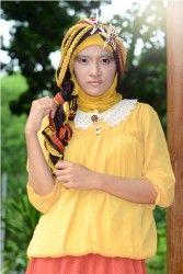 Aisha Chiffon Blouse - Blouse berbahan chiffon, dengan aplikasi karet di bagian pinggang dan perut.  Tersedia dalam warna kuning, biru, hijau, dan orange. Allsize, fit to L.