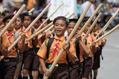 Pramuka (Scout) Day Parade in Lahewa. The Scout movement is huge in Indonesia. Most kids wear scout uniform to school every Friday and often compete with other scout troupes. North Nias Regency, Nias Island, Indonesia. Photo by Bjorn Svensson. www.northniastourism.com