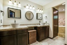 Master bath layout with lots of counter space // Love the round vessel sinks and place to sit