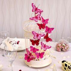 Centrotavola con gabbietta e farfalle