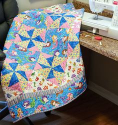 Spinning pinwheels are favorite quilt blocks for kids of all ages. Merry Mermaids, by Nancy Lacey, is made of double pinwheel blocks! If you like the fabrics used in this kids quilt, quilt kits are available while supplies last.
