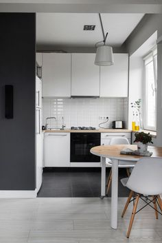 Compact Bachelor Haven in Moscow by M2 Project (20 Eames chair white DSW kitchen nordic