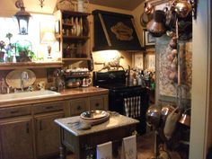 Lovely cozy kitchen with beautiful black range hood!