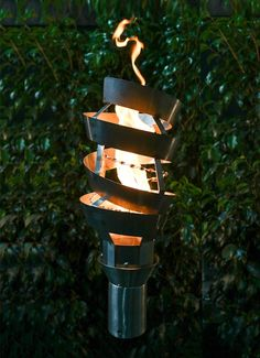 Set the atmosphere aglow by adding decroative modern fire to your outdoor area with Outdoor Fire and Patio's new Gas Tiki Torches. Made to last, each of our TOP Torches Outdoor Torches, Tiki Torches, Outdoor Fire, Tiki Head, Fireplace Doors, Outdoor Lighting, Outdoor Decor, Luxury Pools, Terrace Design