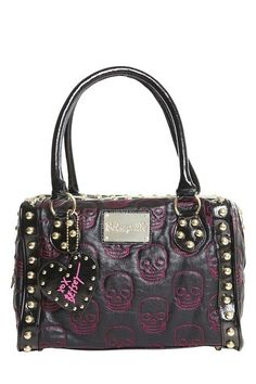 Love this studded-out skull purse by Betsey Johnson <3