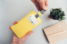 iPhone sleeve yellow with pull-out mechanism, slots for credit cards and ID. Made from high quality leather. Swiss Design, Lemon Yellow, Iphone Cases, Wallet, Cards, Leather, Accessories, Pocket Wallet, Diy Wallet