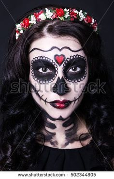 portrait of young woman with skull make up