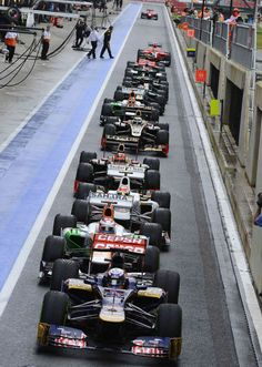 Cars prepare to leave the pit lane during the qualifying session of the British Formula One Grand Prix at Silverstone