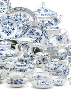 A MEISSEN BLUE ONION-PATTERN COMPOSITE PART TABLE-SERVICE20TH CENTURY, BLUE CROSSED SWORDS MARKS AND VARIOUS PRESSNUMMERN AND INCISED NUMERALSComprising: an oval two-handled soup-tureen and cover, an oval vegetable-dish and cover, a sauceboat on fixed stand, two rectangular butter-dishes and covers, a circular butter-dish and cover, another smaller, a shaped square serving-bowl, a pierced oval two-handled fruit-basket, two oval dishes, a tiered pierced comport, a large sweetmeat serving-dish w Blue Willow China, Blue And White China, Blue Danube China, Blue And White Dinnerware, Blue Onion, Cute Kitchen, White Dishes, Polish Pottery, Ginger Jars