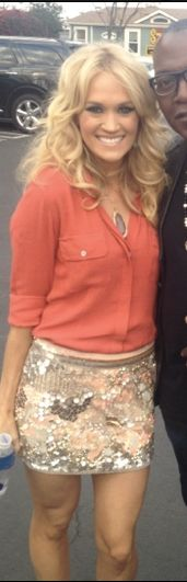 Carrie Underwood - love the color combo & the loose, casual top with the beaded mini